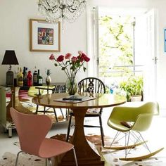 like this space from Living etc, which is grown-up but fun at the same time. The round table, mismatched chairs and chandelier give it an eclectic feeling: Formal Dining Tables, Mismatched Dining Chairs, Antique Dining Tables, Dining Room Table, Dining Rooms, Kitchen Chairs, Room Chairs, Dining Area, Eames Chairs