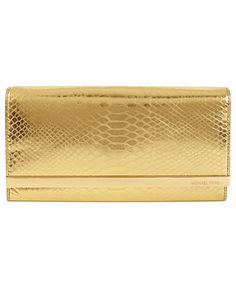 Animal attraction. MICHAEL MICHAEL KORS snake-print gold clutch BUY NOW! MICHAEL