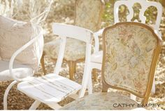 I just love the mismatched vintage chairs.  It gives it a shabby feel, and yet still has a feel of elegance, because of the chairs being vintage.