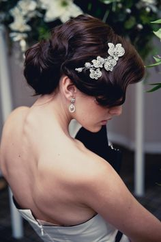 Low chignon wedding hairstyle by The Bridal Stylists