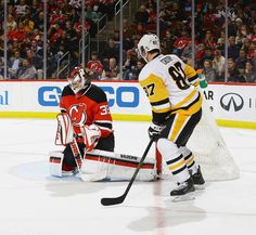 Devils vs. Penguins - 12/27/2016 - Pittsburgh Penguins - Photos  Cory Schneider #35 of the New Jersey Devils makes a stick save as Sidney Crosby #8