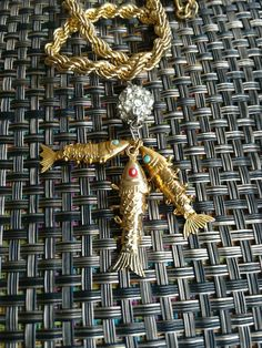 Check out this item in my Etsy shop https://www.etsy.com/listing/238111493/gold-fish-necklace-free-shipping-vintage