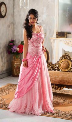 Designer Pink Shade Embroidered Net Gown Price: Usa Dollar $296, British UK Pound £174, Euro217, Canada CA$316 , Indian Rs15984.