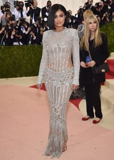On the red carpet, Kylie Jenner in a custom-made Balmain gown at the 2016 MET gala. #BALMAINARMY