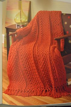 Crochet patterns for 6 different Aran Afghan Blankets. Each of these designs features an aran crochet pattern complete with lots of pictures and wonderful instructions. These make a wonderful gift or are perfect to fit your home decor!
