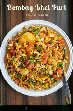 Bhel Puri is a popular Indian snack made with puffed rice, vegetables like boiled potatoes, tomatoes & onions, flavored with tangy chutneys. Bhel puri is a popular Indian savory snack made with puffed rice, tossed with vegetables and tangy chutneys. Vegetarian Snacks, Savory Snacks, Healthy Indian Snacks, Bhel Puri Recipe, Chutneys, Chats Recipe, Indian Veg Recipes, Puri Recipes, Indian Street Food