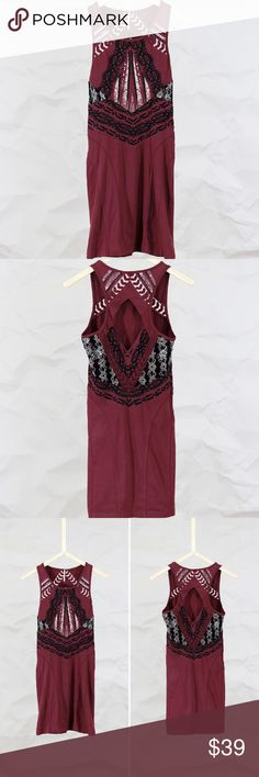 """Free People - Tribal Print Bodycon Dress Graphic printed body-conscious mini dress with cool netted detailing at side of each waist. Sheer embroidered mesh trimming near the front armholes, upper back and lower back. Diamond-shaped cutout detailing at upper back.  Size: S  Condition Very Good. Light wear to fabric.  95% Cotton 5% Spandex  Size & Fit Fits true to size, take your normal size Length: 34"""" = 86.36 cm Bust (all around - relaxed): 29"""" = 73.66 cm Waist (all around - relaxed): 27""""…"""