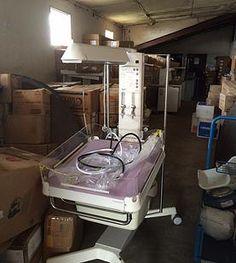 Maternal Childhealth Advocacy International | LIBERIA - Neonatal resuscitaires and platform incubator from Alderhey Hospital inside warehouse at Phebe.