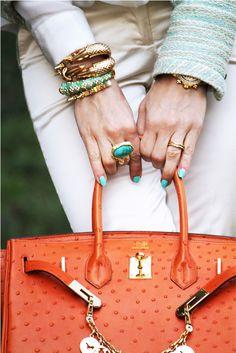 Hermes satchel, orange with turquoise accessories.