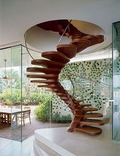 Beautiful spiral stairs - a functional feature at its best. www.mirabellointeriors.com