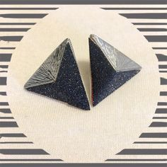 Geometric Earrings Silver and black sparkle earrings. They kind of remind me of a shark tooth! Super cute and on trend. Love love love these!!! uponthemoon Jewelry Earrings