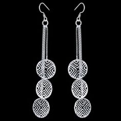 Silver earrings, chains Silver earrings, Ag 925/1000 - sterling silver. Dangle earrings. Rhodium-plated. Etheral earrings comprise of three chains (pattern of small squares) with lenght 40, 30 and 20mm ended with flat carved circles with diamater approx. 11mm. Price per pair.