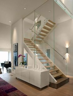 Modern staircase wall design glass staircase wall designs with a graceful impact on the overall decor Glass Stairs, Floating Stairs, Glass Railing, Glass Walls, Glass Balustrade, Stairs With Glass Panels, Interior Stairs, Interior Architecture, Beautiful Architecture