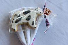 Cow cookie favors from Jocelyn and Wills Hot Pink Dairy Farm Wedding