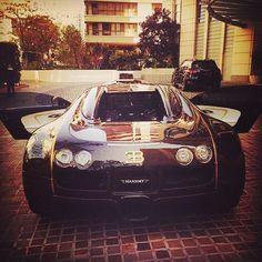 Black Bugatti with a gold trim! Gangsta!