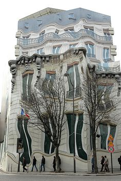 During the 2007/8 renovations of a Hausmann designed building in Ave George V (Paris) 'Athem', was asked to build a false front to conceal the renovation. Sculptor Pierre Delavie, photographed the original facade, distorted the image and created a giant work of 'urban surrealism' on an 8,200 square-foot canvas from polystyrene, resin, and metal. Delavie's melting building caused enormous interest and amusement during the renovations.