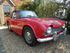 A 1962 Triumph TR4 two door sports car, registration No. MSU 949, in red finish