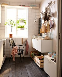 The same small kitchen is now outfitted to suit a parent with a small child. There is plenty of storage, cooking untensils hung from rails, and a play-kitchen for the child.