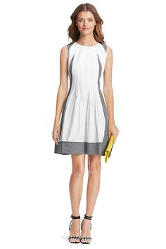 Fresh and modern, the DVF Samella is our dream sundress. Fine pleating detail and a subtle flare skirt flatters all. In crisp cotton with just the right amount of gingham. Back zip. Falls to mid thigh. Fit is true to size.