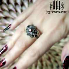 3 Rexes Jewelry - Princess Love Gothic Engagement Ring with garnet and 2 stacking rings (stacking rings are extra), $120.00 (http://www.3rexes.com/princess-love-gothic-engagement-ring/) #silverrings www.3rexes.com
