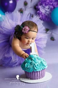 Purple and teal giant cupcake cake smash. Girl peacock theme Miss A is one! Sonoma County Cake Smash Photographer Miss A is one! Sonoma County Cake…
