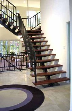 """Monostringer staircase with 1 3/4"""" Cherry Treads and a 1 5/16"""" steel rail"""
