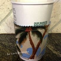 """This adorable and functional coffee """"cozy"""" is one of a kind!  Recycling the cardboard sleeve from a local coffee shop, it is sandwiched in between a piece of denim and a Hawaiian shirt with a retro surfboard print.   Wraps around securely with Velcro.  Surely to let your friends know that you..."""