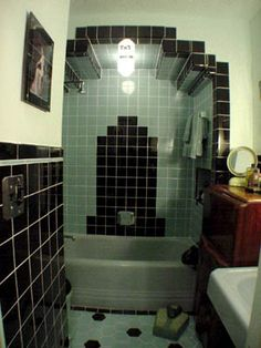 Arch over tub ...Proving that art deco can work just as well in a small space with this wonderfully designed bathroom.
