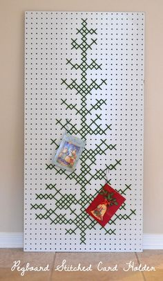 A big piece of pegboard meets cross stitch by way of yarn. Such a fun way to show off your holiday cards! Christmas Tree Card Holder, Christmas Art, Christmas Projects, Holiday Crafts, Christmas Ideas, Aussie Christmas, Christmas Sewing, Christmas Things, Holiday Ideas
