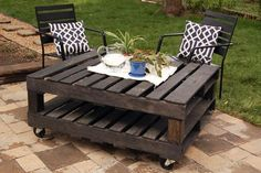 Two pallets, 4x4 blocks and wheels casters. Makes a great outdoor table :)
