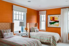 With a brightorange wall covering from Phillip Jeffries and patterned bed upholstery and linens, this bright and fresh room is perfect for younger guests.