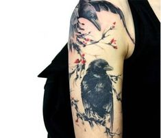 Simple Flower And Black Ink Angry Raven Crow Sitting In Tree Tattoo