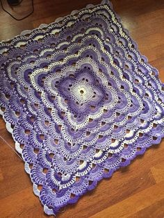 """Baby blanket, queen coverlet or king sized bed spread, this beautiful crochet blanket is so easy to make. Virus Blanket by Jonna Martinez is a simple pattern with four repeating rows. This blanket works up very quickly and """"grows"""" to the size you wish very similarly to a granny square. ——————————————— You will need~ Yarn: … by jenna"""