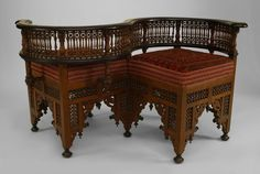 Middle Eastern Moorish style (19th Cent) walnut carved tete-a-tete with ebonized trim and inlaid with mother of pearl and 2 seats upholstered with Persian rug fragments Price $16,500.00