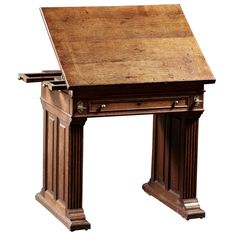 An Arts And Crafts Period Oak Drafting Table With Adjustable Slope
