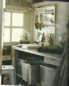 inside of shed w/ galvanized bins