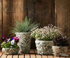 Give simple store-bought pots an all-natural, expensive look with just a few simple steps. Seal your pot using outdoor spar urethane. Use a utility knife to cut a sheet of pebble mosaic tile to fit a tapered pot, cutting out and placing individual pebbles as needed. Wearing waterproof gloves, spread construction adhesive lightly on half of the pot, press pebbles into place, and hold until the adhesive sets (usually a few minutes). Repeat the process, covering the remainder of the pot with…