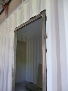 how to cutout and install a door frame in a shipping container house construction