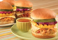 Hawaiian Turkey Burger-Beat egg & add ground turkey, 1/4C oats,Crushed red pepper(1T) ,Parsley(2T), Salt & Pepper, 1clove-MinceGarlic,1/2 c minced red pepper Mix/divide into 4 patties & put in fridge. Mix 1/4C mayo & 1/4C BBQ sauce,Set aside.Grill med/high 5-7mins a side. Brush 1T oil on pineapple slices, onion & green pepper, grill 2-3 mins per side. Grill buns/put on the mayo BBQ sauce. Melt cheese slice on burgers. Layer on bottom bun cheese patty pineapple, onion, green pepper.