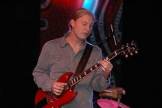 Stumped by last week's Artist of the Month trivia? No worries – here's another change to enter to win a Derek Trucks guitar print, signed by Lisa S Johnson! Just comment below with the correct answer: Out of these artists, which one has Derek Trucks toured with? A.) Robert Plant B.) Ted Nugent C.) Peter Frampton D.) Bruce Springsteen E.) Eric Clapton F.) Paul McCartney
