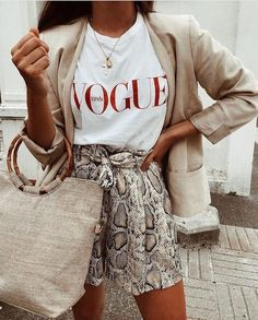snake skin shorts with a vogue t-shirt and tan blazer. Visit Daily Dress Me at dailydressme.com for more inspiration women's fashion 2018, summer fashion, business casual, t-shirts,