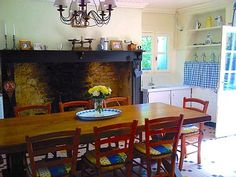 Country kitchen with authentic fireplace and seating for 12.