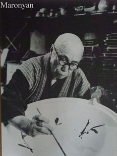 National Living Treasure of Japan, Shoji HAMADA (1894~1978), pottery artist, at work.