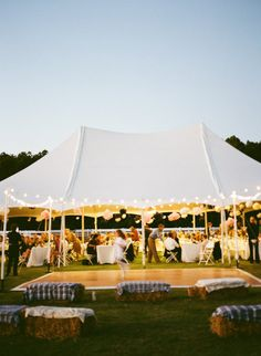 Look how they did the.dance floor outside the tent!!! With poles in the ground amd.christmas lights. That's a thought