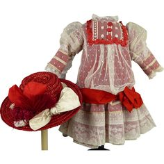 Wonderful red silk and dotted gauze antique dolls dress with matching red straw hat