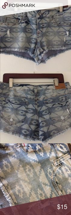 Rue 21 low rise jean shorts Faded Aztec printing! Low rise, size 7/8 in women's or juniors, super cute shorts with fringe lining at the bottom Rue 21 Shorts Jean Shorts