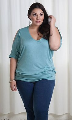 A sweet and feminine plus size top in a classic, pull-on style. Cold-shoulder sleeve style shows just a bit of skin. The perfect throw and go top for day to night style.