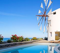 This special and luxury holiday villa in Santorini is awindmill, designed in a minimalist, artistic style with eco-friendly materials. Santorini Villas, Santorini Island, Santorini Greece, Greece Hotels, Luxury Holidays, Lush Green, Summer Colors, Luxury Villa, Luxury Travel