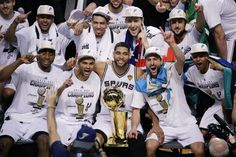 San Antonio Spurs win NBA title in five games over Miami Heat - The San Antonio Spurs pose for a photo after Game 5 of the NBA basketball finals against the Miami Heat on Sunday, June 15, 2014, in San Antonio. The Spurs won the NBA championship 104-87. (AP Photo/Tony Gutierrez)