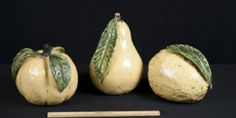 LARGE CERAMIC FRUIT PAINTED IN YELLOW AND GREEN